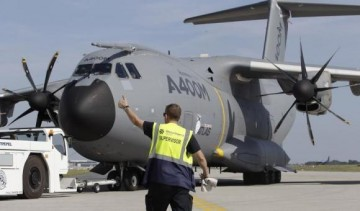 Flight supervisor leads Airbus A400M into position for ILA Berlin Air Show in Selchow